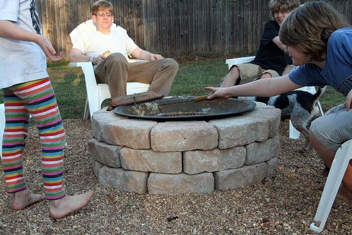 People Gathered Around An Diy Backyard Fire Pit