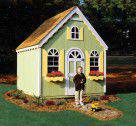 Wood playhouse with light brown shingles