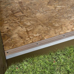 Entryway is protected by an aluminum threshold.