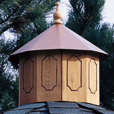 Carved cedar base & copper color metal roof & wood finial.